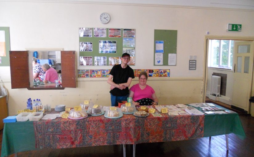 Serving Cream Teas in aid of Open Doors