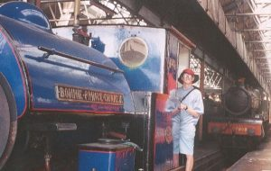 Simon standing on the cab of Bonnie Prince Charlie in the engine shed.