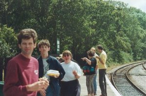 Isle of Wight 1996 After getting off the Island Line train at Smallbrook Junction, the group are seen having their lunch whilst waiting for the steam train to arrive. David, Adrian, Louise, Mary, Steve and John are seen on the photo.