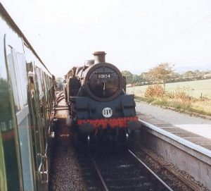 Std Tank No 80104 is seen passing our train at Harman's Cross station, which is now a passing point for a two or three train service.