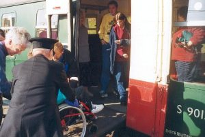 Adam is seen being unloaded from the coach helped by Howard, Steve and the guard after arrival back at Swanage.